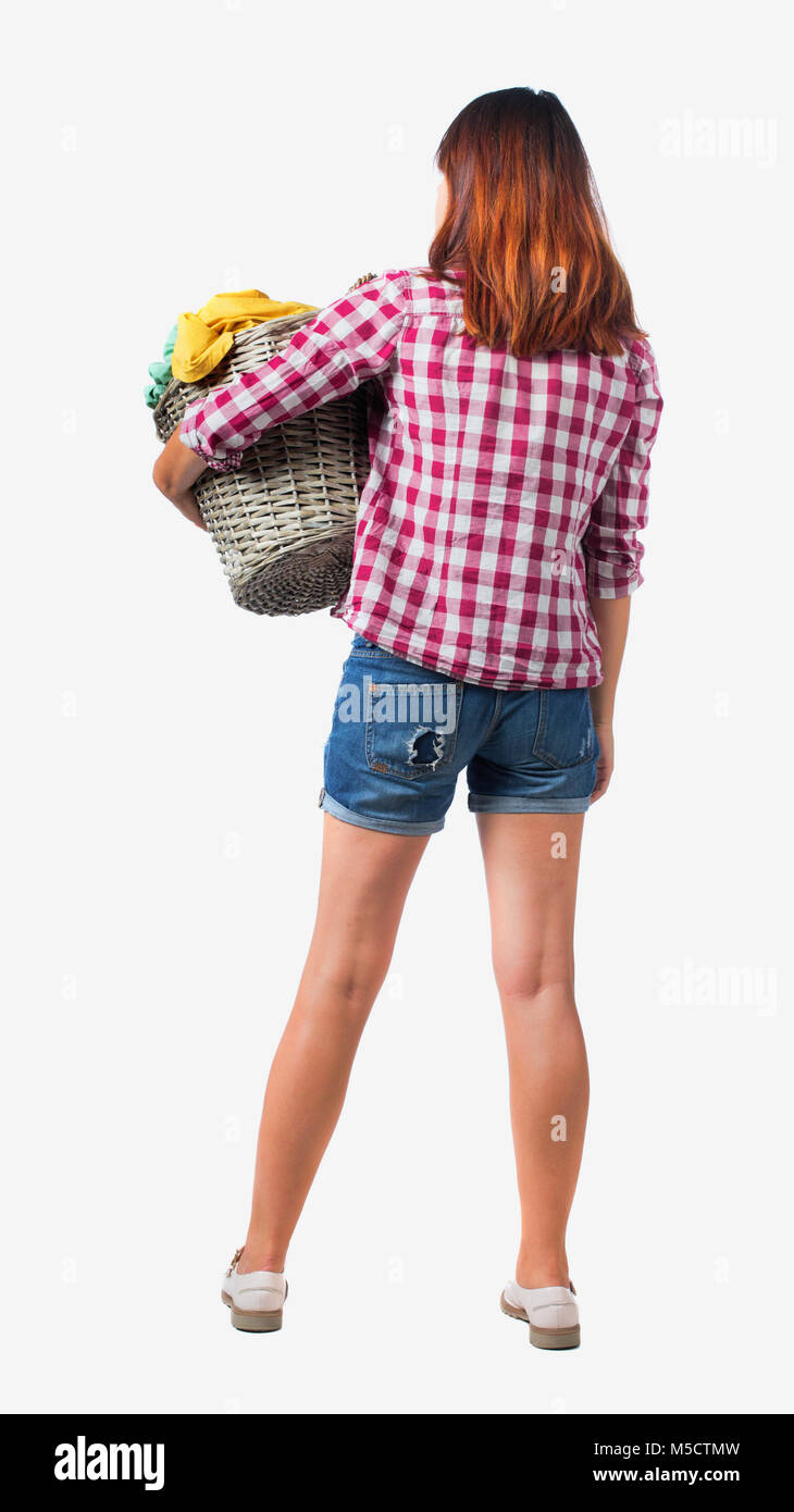 Back view of woman with basket of dirty laundry  girl is