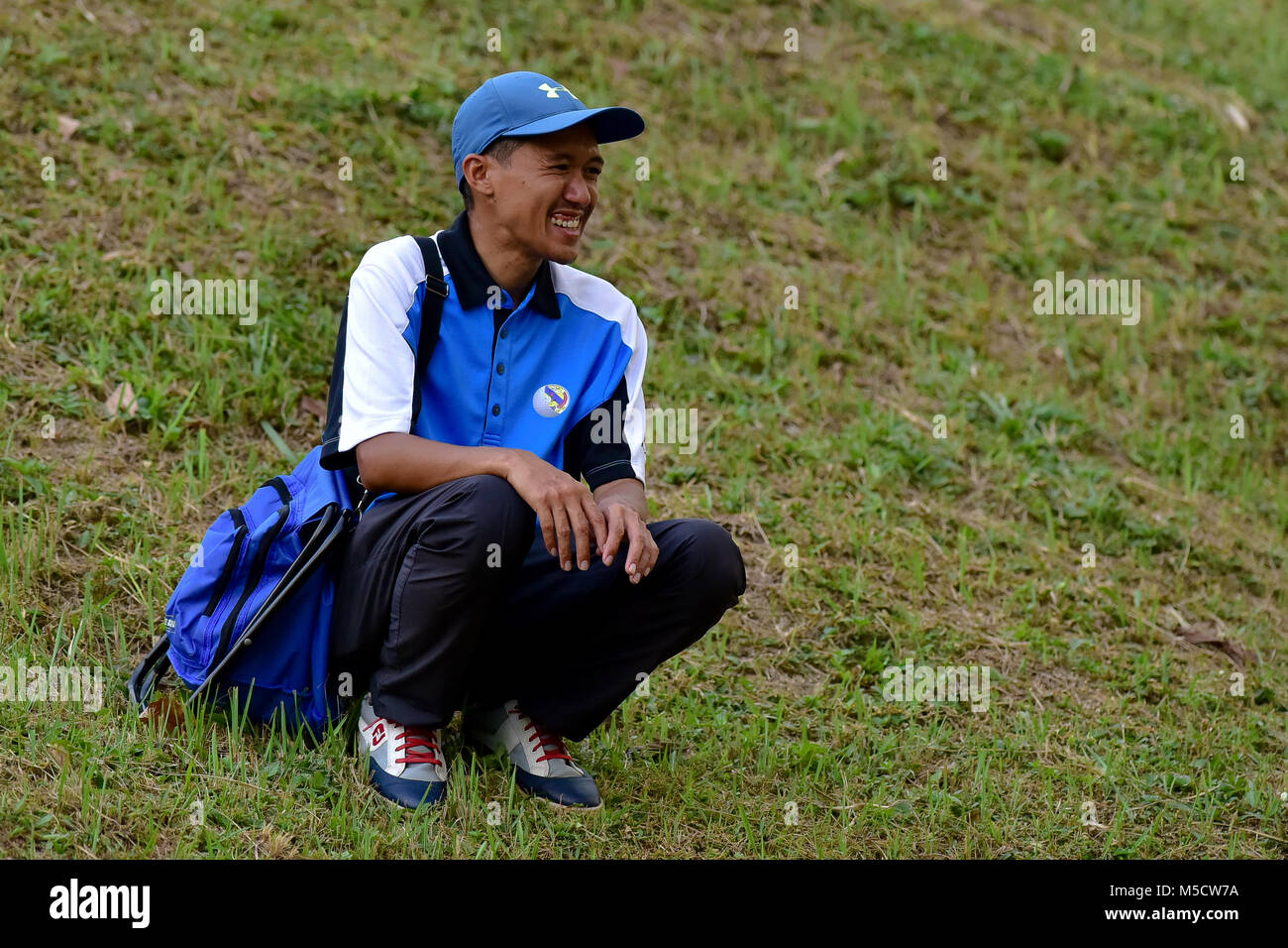 Danau, UKM Bangi - FEBRUARY 10: Spectators watching a tee shot on the 11th hole during Round One of the Danau Junior - Stock Image