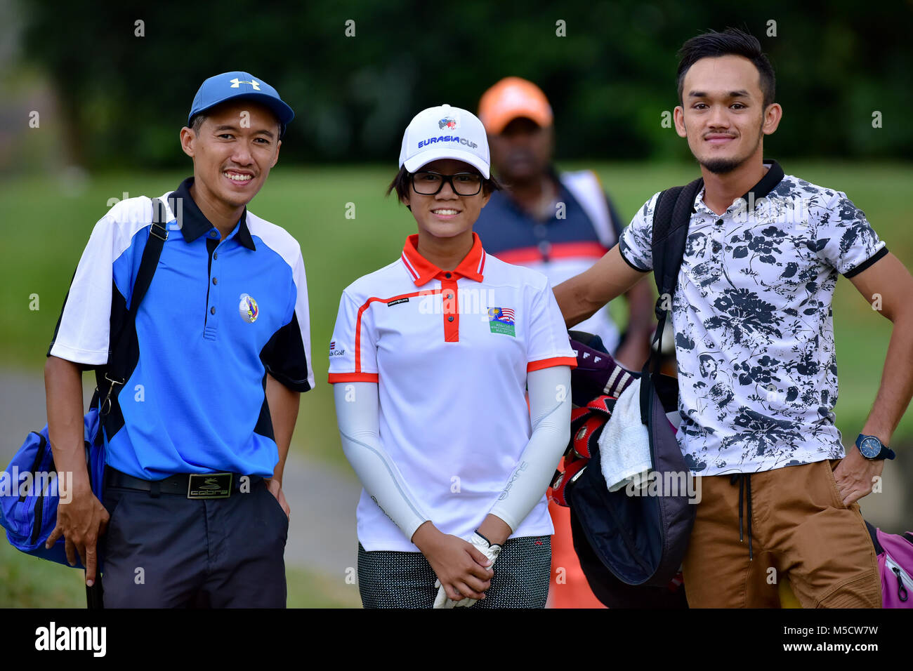 Danau, UKM Bangi - FEBRUARY 10: Eireen Syafeeya takes a photo with her caddie and father on the 11th hole during - Stock Image