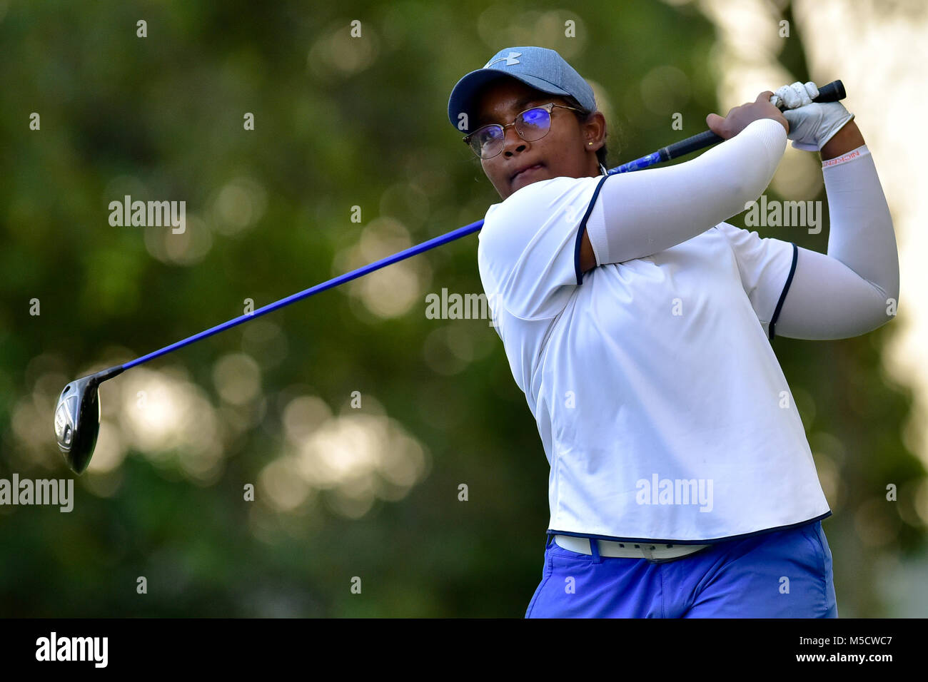 Danau, UKM Bangi - FEBRUARY 10: Caitlyn Ambrose  watches her tee shot on the 11th hole during Round One of the Danau - Stock Image