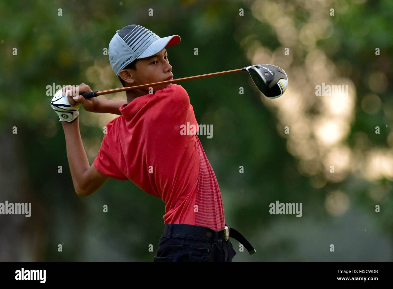 Danau, UKM Bangi - FEBRUARY 10: Muhd Afnan Hanif watches his tee shot on the 15th hole during Round One of the Danau - Stock Image