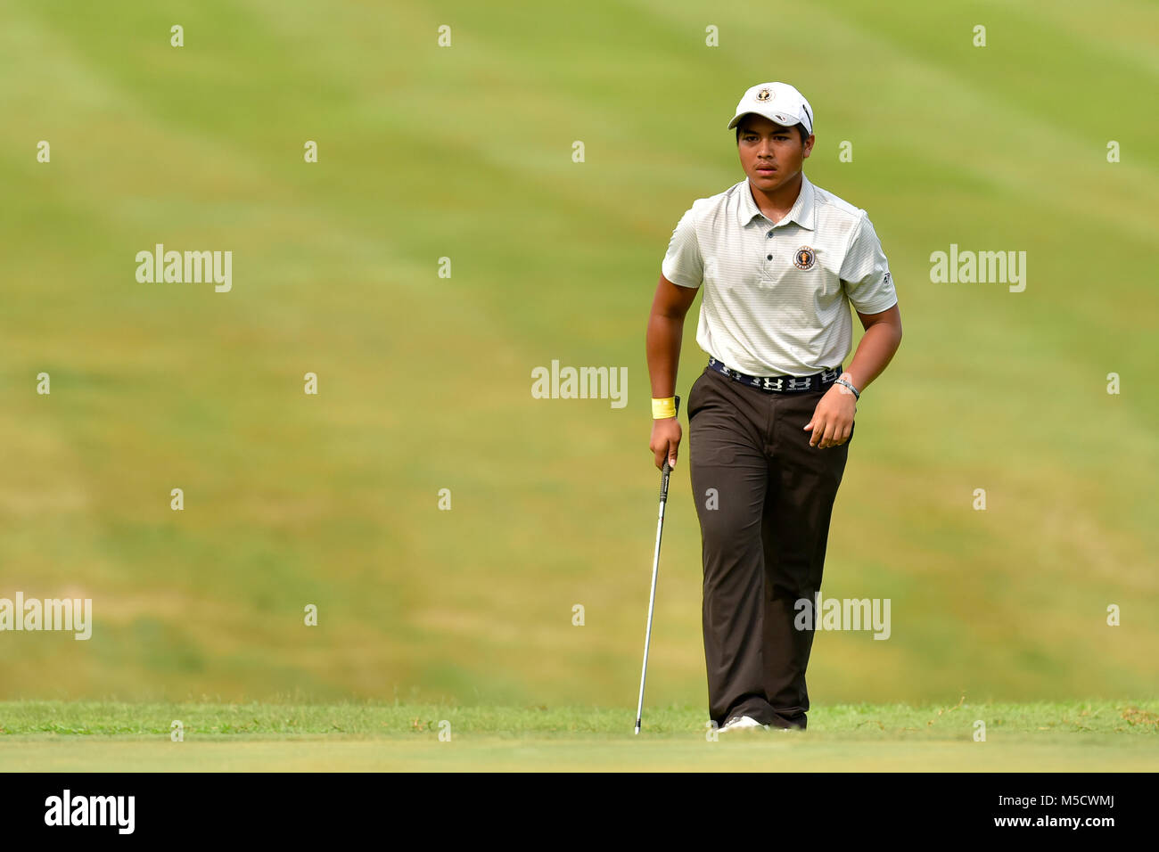 Danau, UKM Bangi - FEBRUARY 10: Hadi Irfan walks across on the 5th green during Round One of the Danau Junior Championship - Stock Image