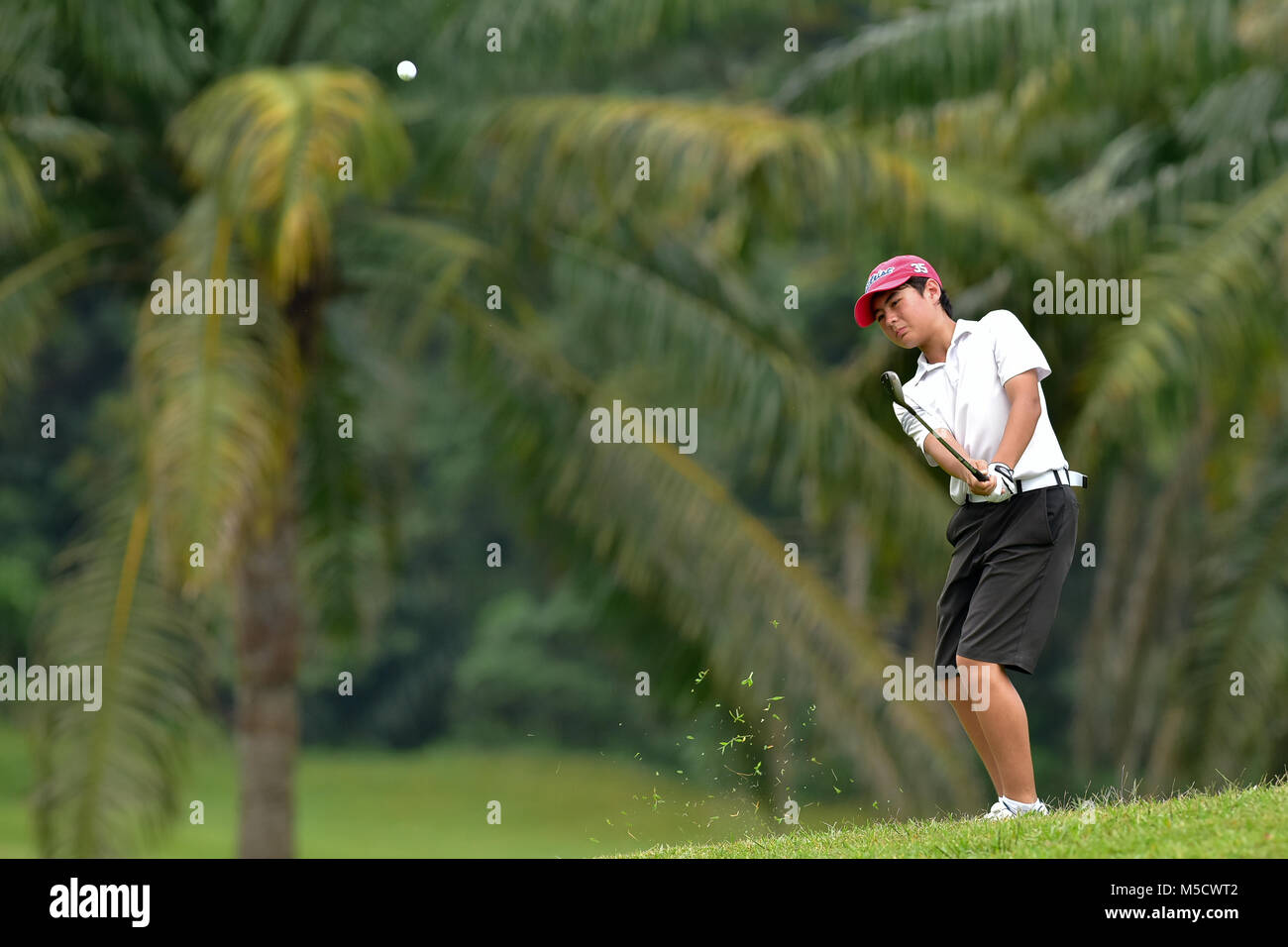 Danau, UKM Bangi - FEBRUARY 10: Jake Foley plays his shot  on the 6th hole during Round One of the Danau Junior - Stock Image