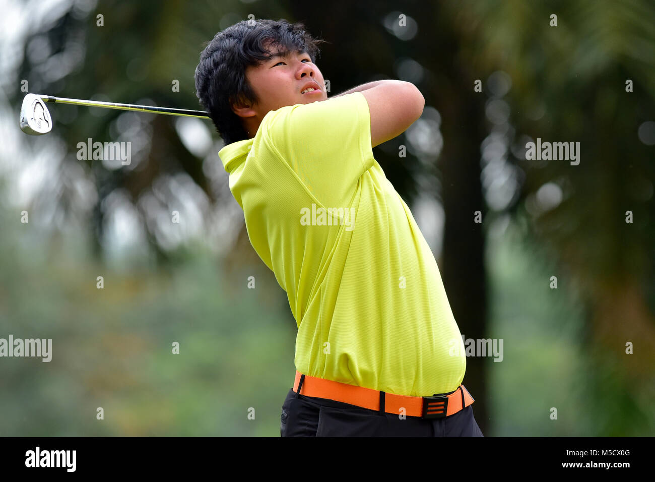 Danau, UKM Bangi - FEBRUARY 10: Ryan Wei Jian takes his tee shot on the 6th hole during Round One of the Danau Junior - Stock Image
