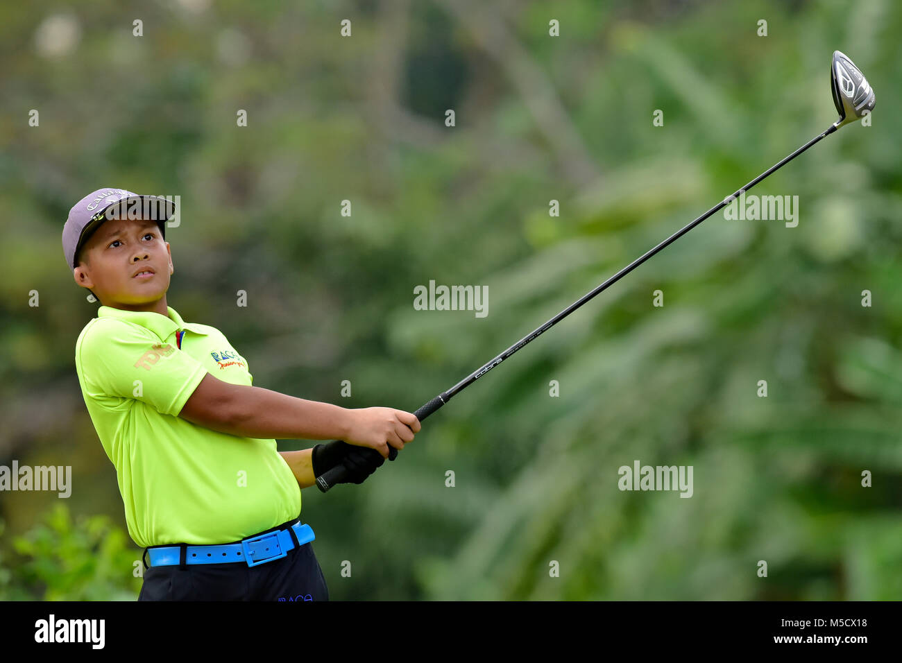 Danau, UKM Bangi - FEBRUARY 10: Aniq Nizam takes his tee shot on the 12th hole during Round One of the Danau Junior - Stock Image