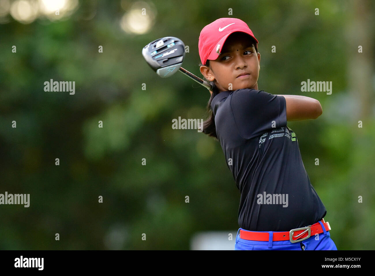 Danau, UKM Bangi - FEBRUARY 10: Kaathiyayani Gunasegar takes her tee shot on the 11th hole during Round One of the - Stock Image