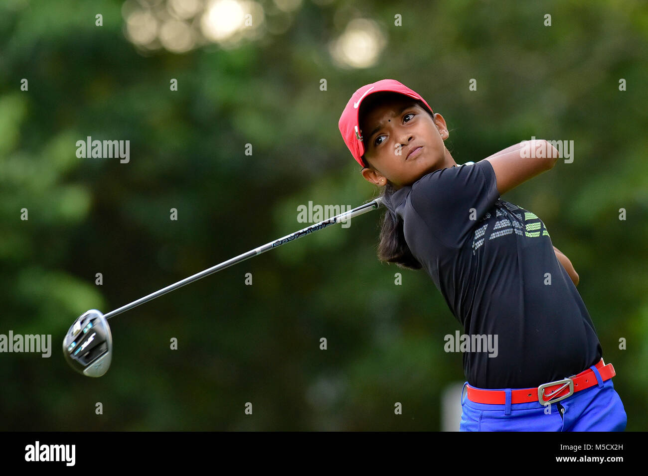 Danau, UKM Bangi - FEBRUARY 10: Kaathiyayani Gunasegar watches her tee shot on the 11th hole during Round One of - Stock Image