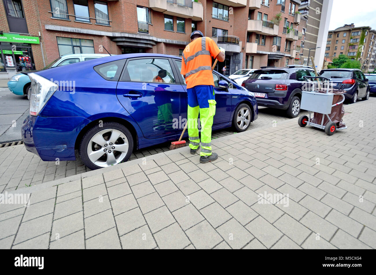 Brussels, Belgium. Street cleaner in a high vis vest - Stock Image