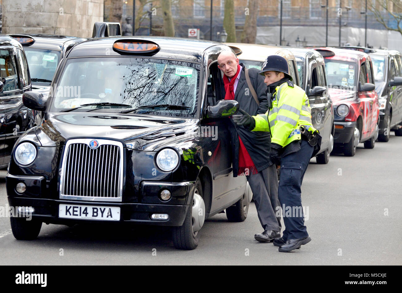 London, England, UK. Police and taxi drivers during a protest against the Uber taxi app Stock Photo