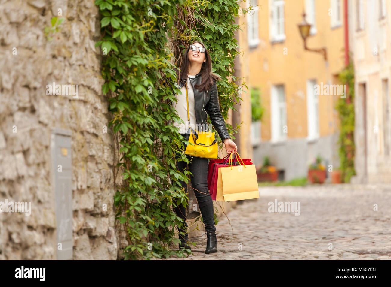 Fashion model made shopping and bought dress holding in bags - Stock Image