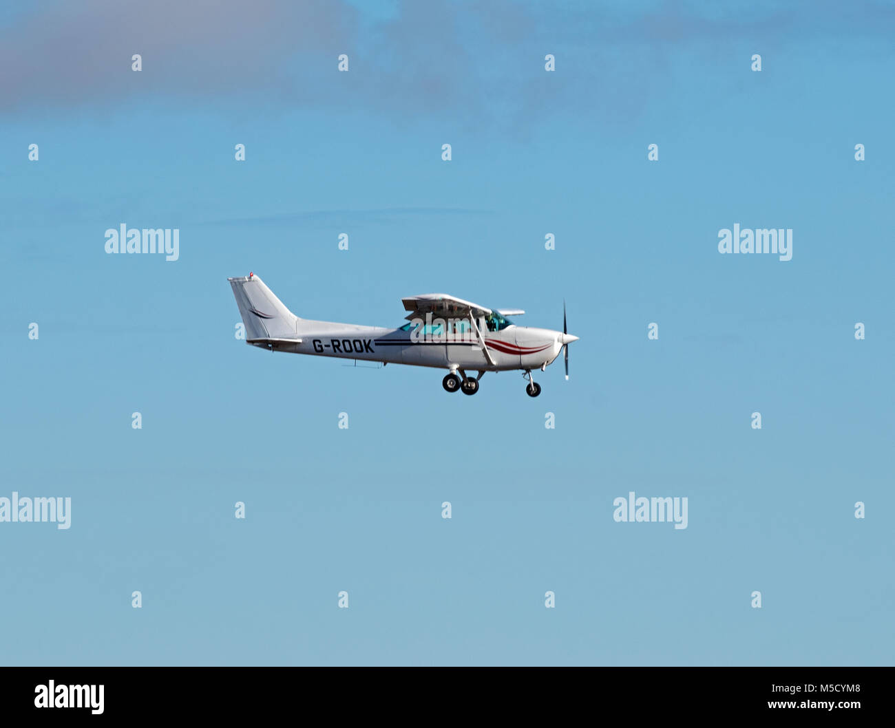 Reims Cessna 172P four seat light private aircraft coming in to land at Aberdeen Dyce airport, Grampian Region. - Stock Image