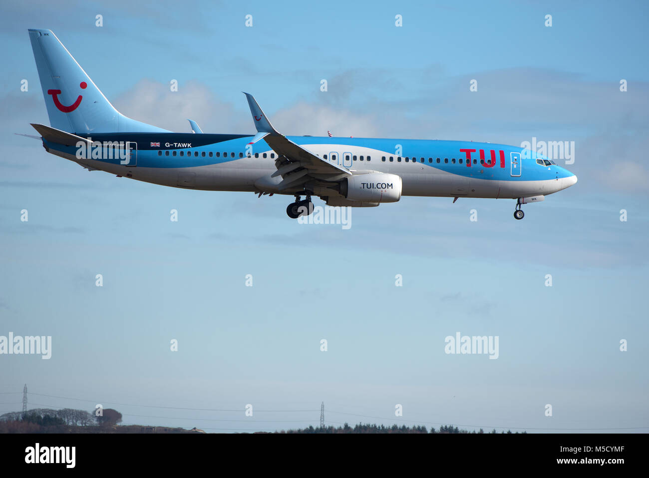 A Boeing 737-800 holiday flight returns to Aberdeen after the passengers had enjoyed a break in the Mediterranean sun. Stock Photo
