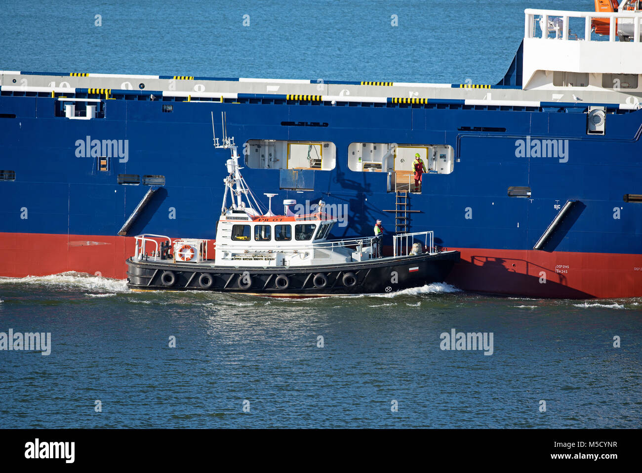 The Vestland Cetus Offshore North Sea Supply ship depart from Aberdeen escorted by the Sea Shepherd Pilot boat. - Stock Image
