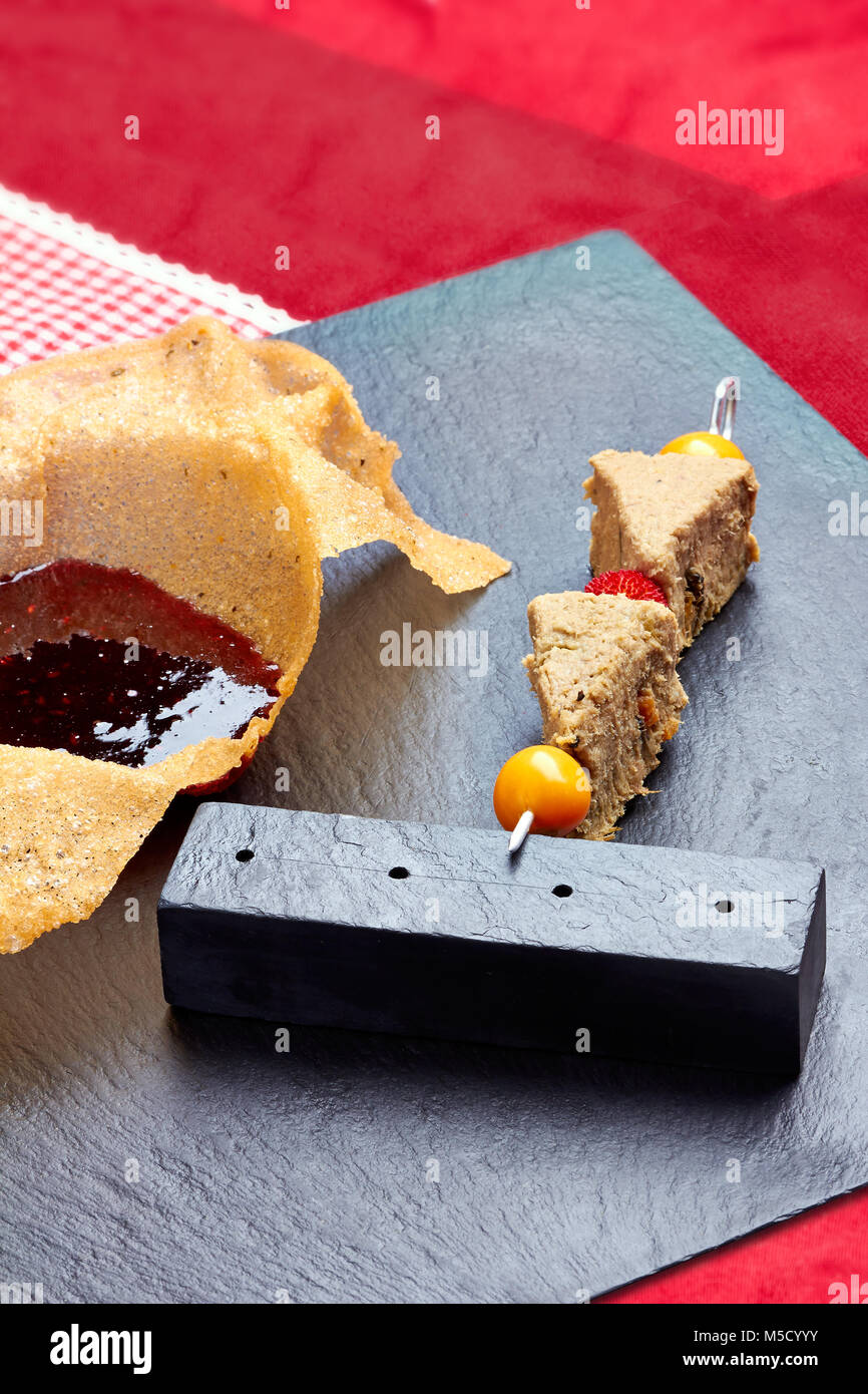 Skewer with pate of poultry and berry jam - Stock Image