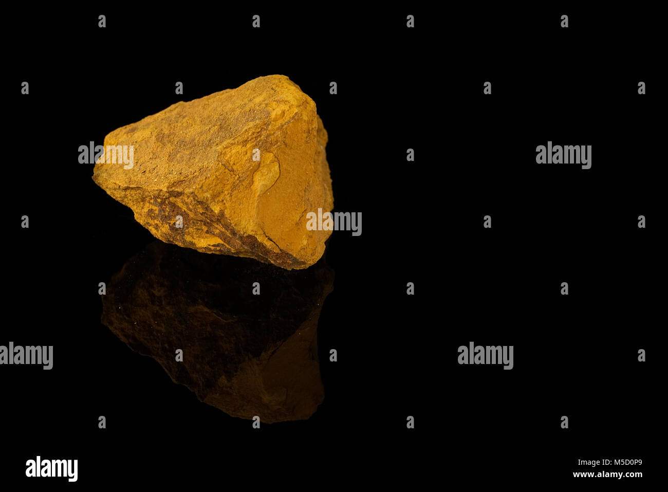 Limonite, iron ore mineral, iron oxide-hydroxide, amorphous, mineraloid, fine grained aggregate with powdery coating - Stock Image