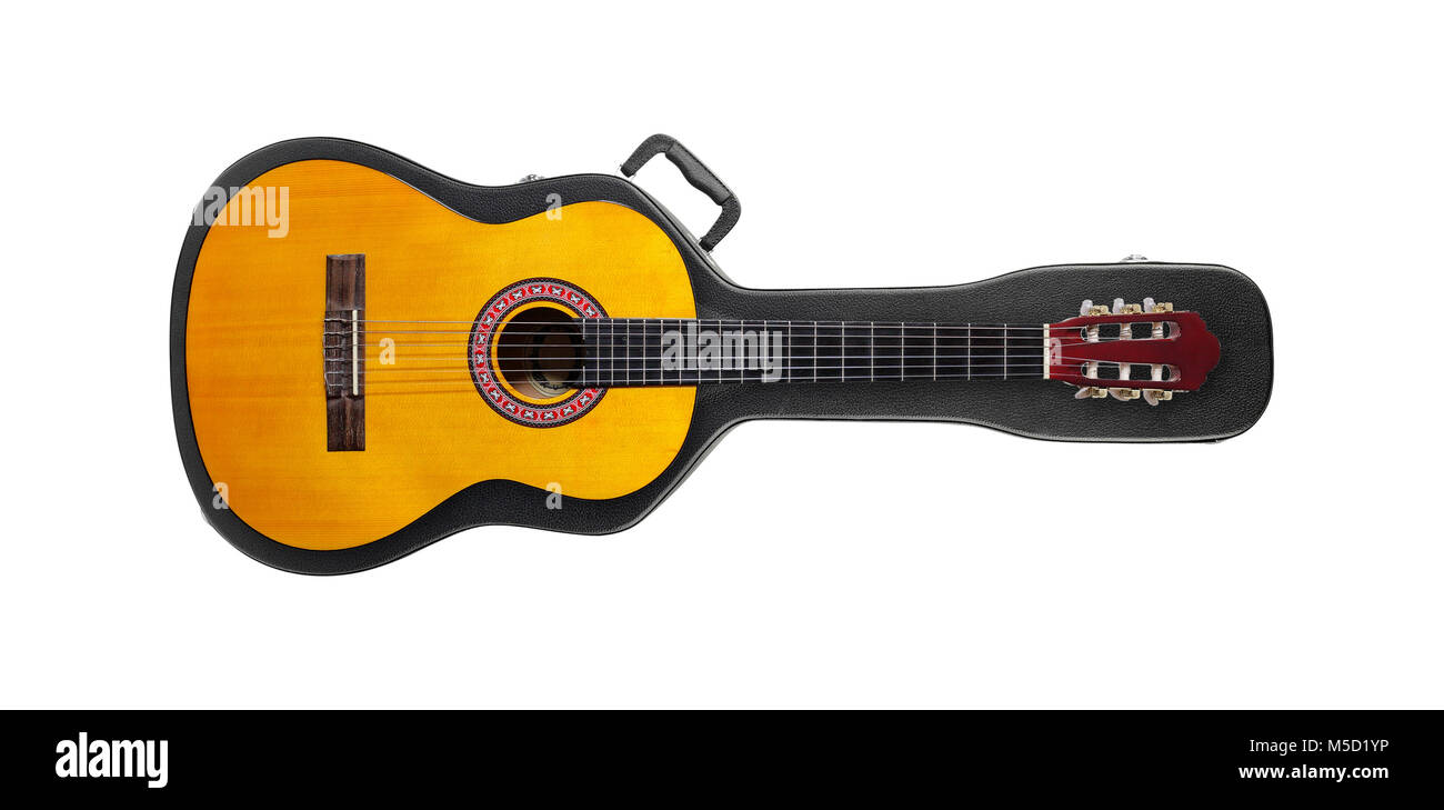 Musical instrument - Acoustic classic guitar from above on a hard case on a white background. Stock Photo