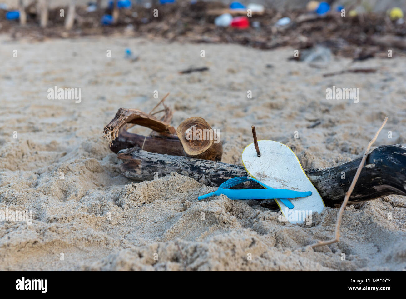 Rubbish and domestic waste polluting the beach Stock Photo