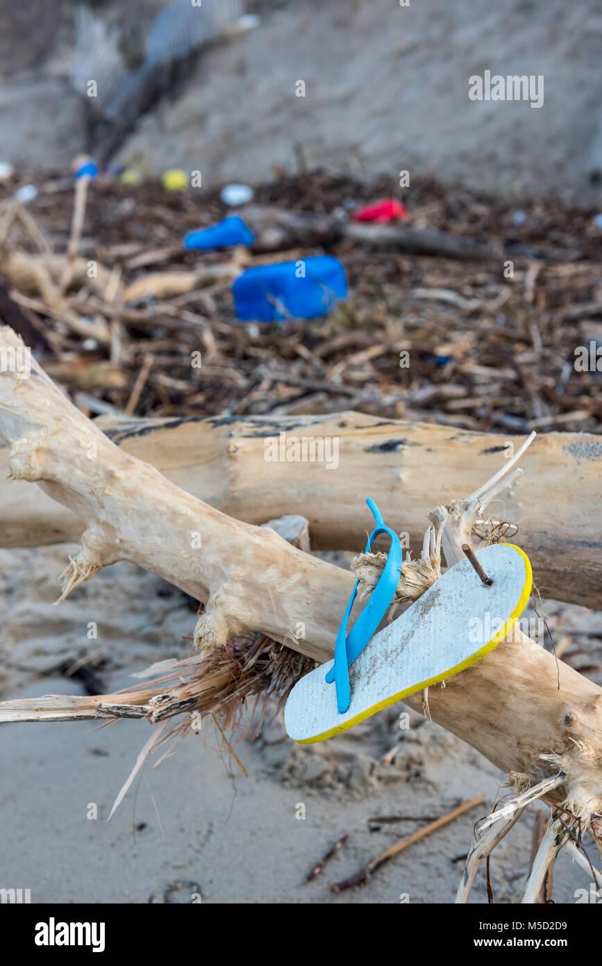 Rubbish and domestic waste polluting the beach Stock Photo