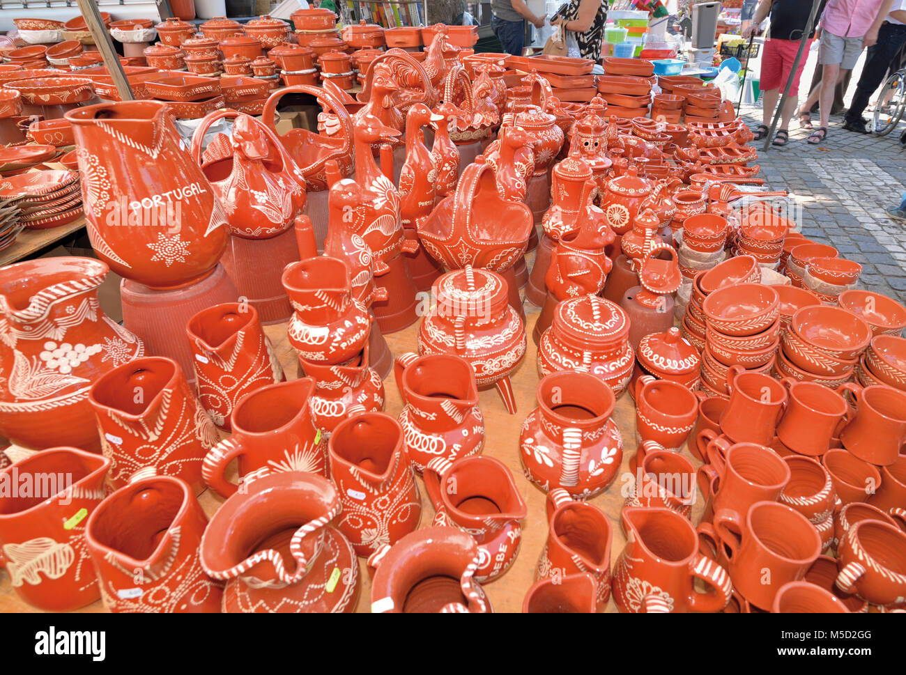 Terracotta ceramics on market stand - Stock Image
