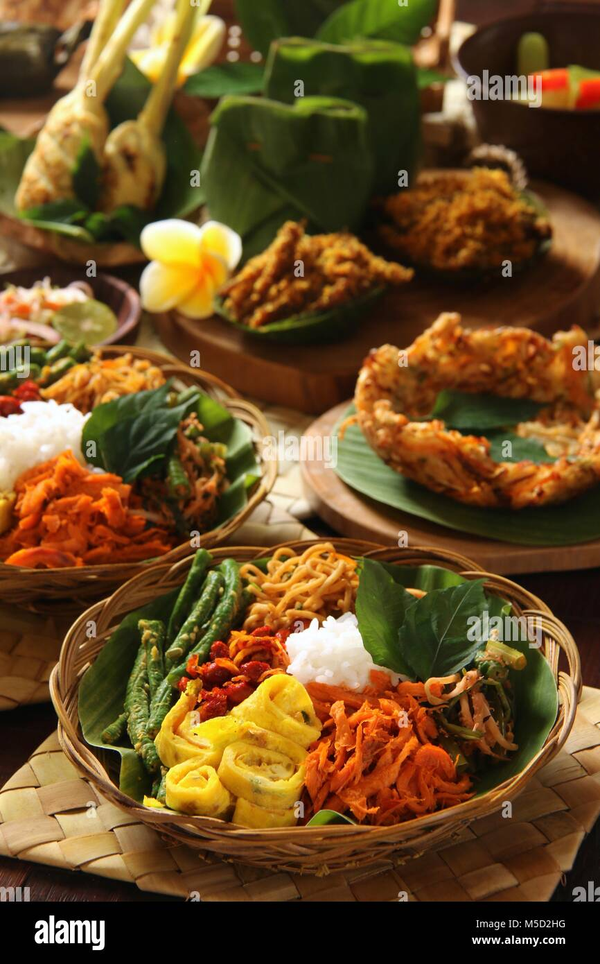 Nasi Campur Bali. Popular traditional Balinese dish of steamed rice served with various side dishes. - Stock Image