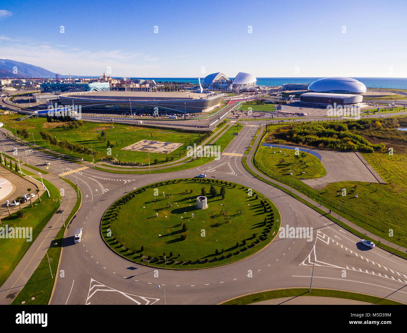 Drone view of Olympic Park and roundabout in Adlersky City District in sunny day, Sochi, Russia - Stock Image