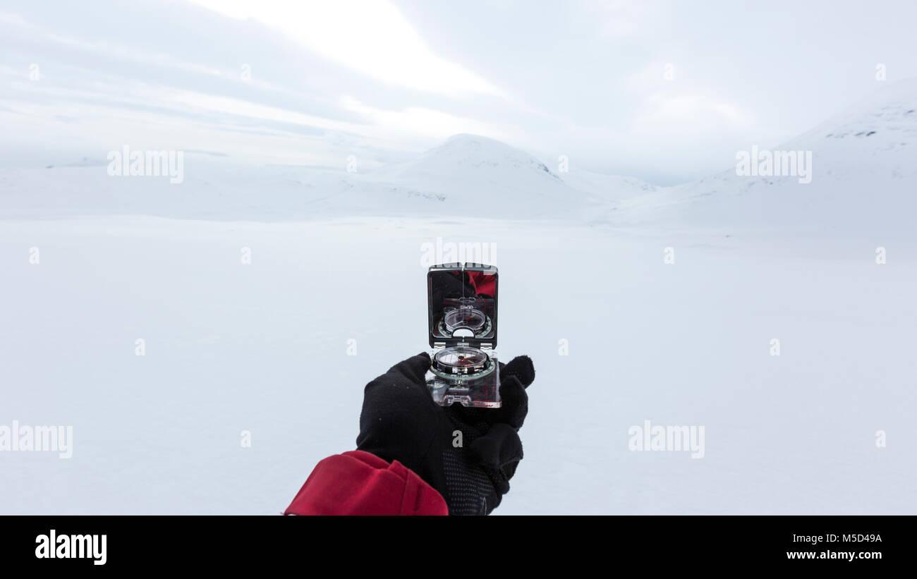 Navigation with compass in winter, Kungsleden or Königsweg, Province of Lapland, Sweden, Scandinavia - Stock Image