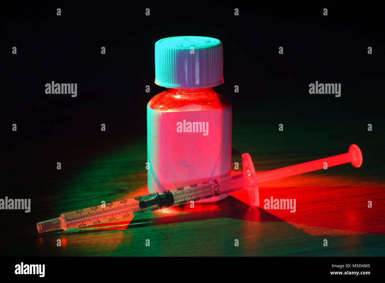 Syringe - medical measure with blank bottle, for delivering liquids, no needle attached - Stock Image