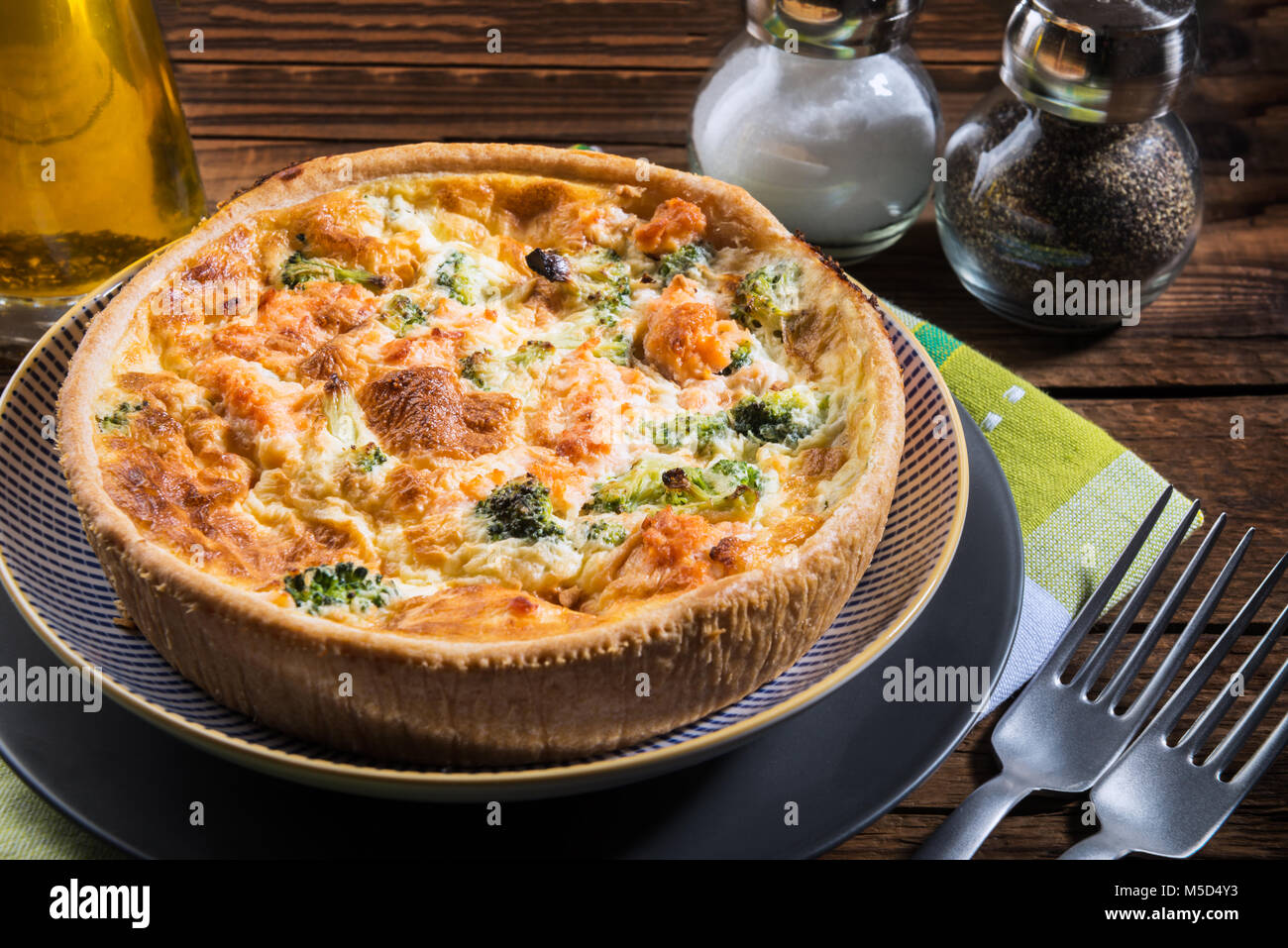 Classic salmon and broccoli quiche made from shortcrust pastry with broccoli florets and smoked salmon in a creamy - Stock Image
