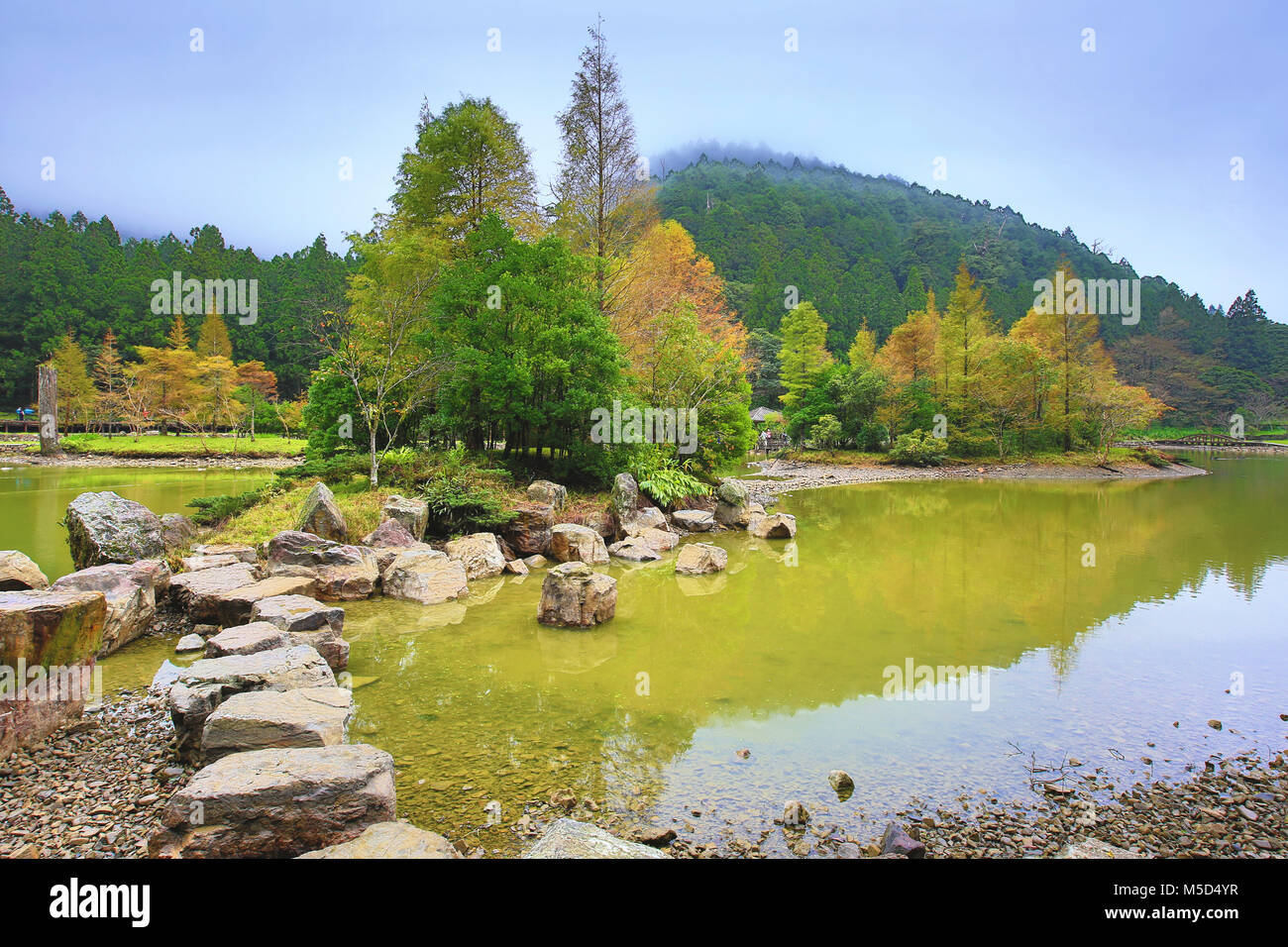 Beautiful lake scenery with colorful trees and rocks in autumn Stock ...