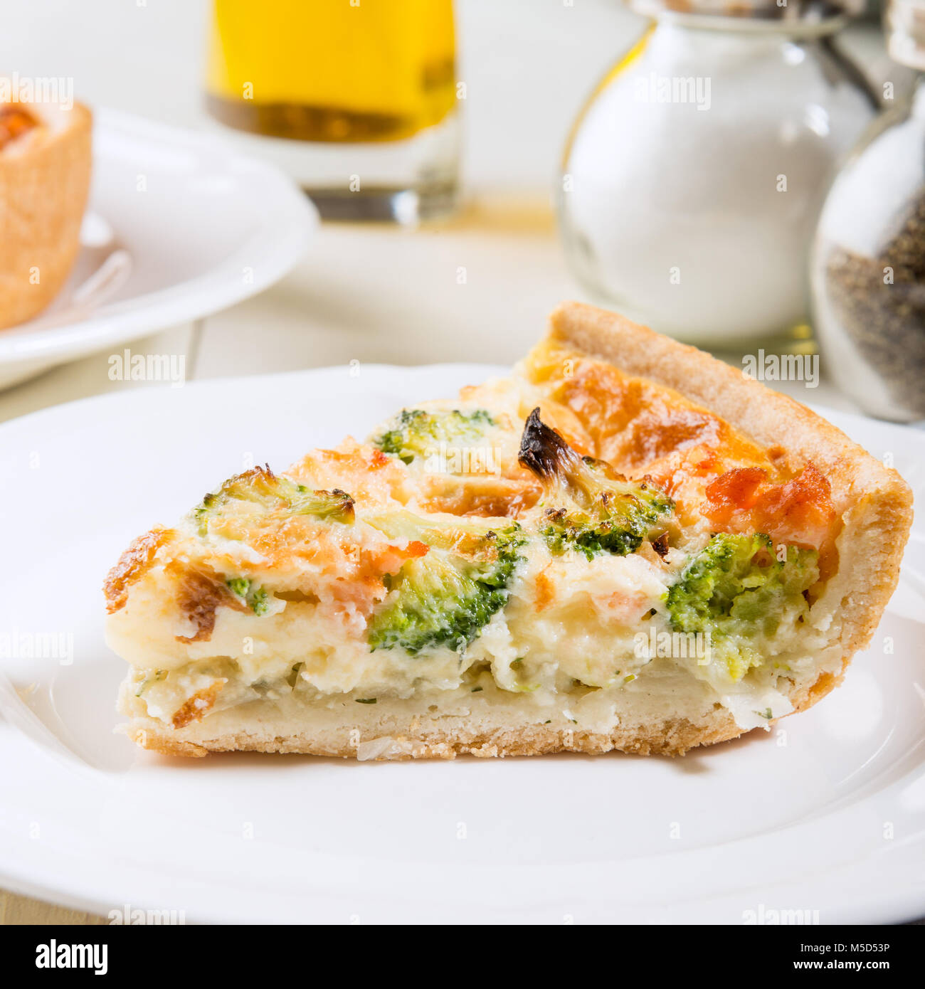 Classic salmon and broccoli quiche made from shortcrust pastry with broccoli florets and smoked salmon in a creamy Stock Photo