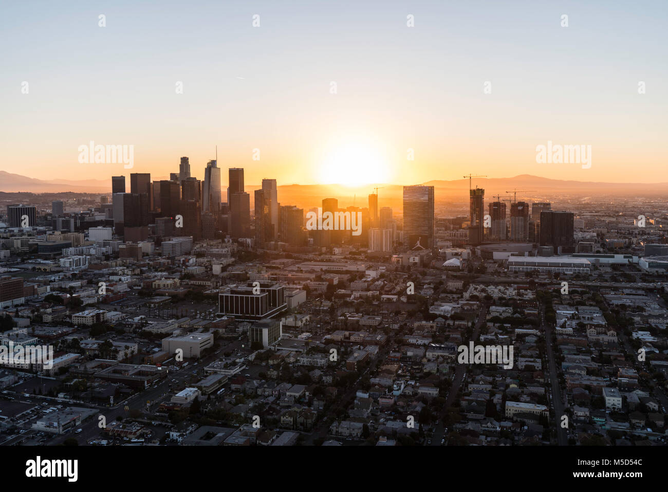 Los Angeles, California, USA - February 20, 2018:  Aerial view of morning sunrise behind urban buildings in downtown Stock Photo