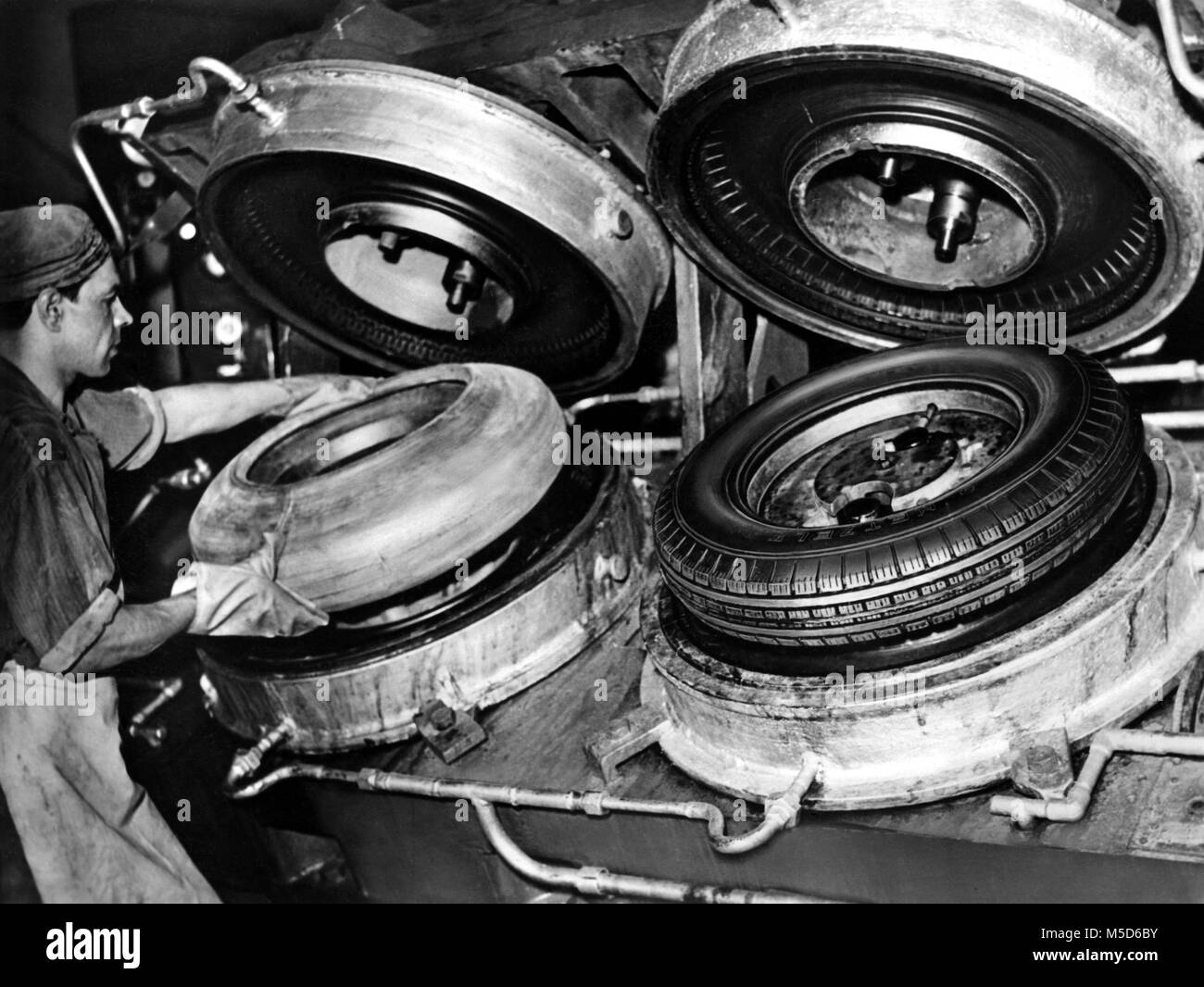 Industry, car tires, production, fresh punched tires, 1950s, Germany - Stock Image