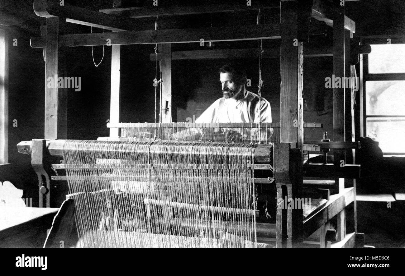 Weaving mill, man at the loom, 1910s, Germany - Stock Image
