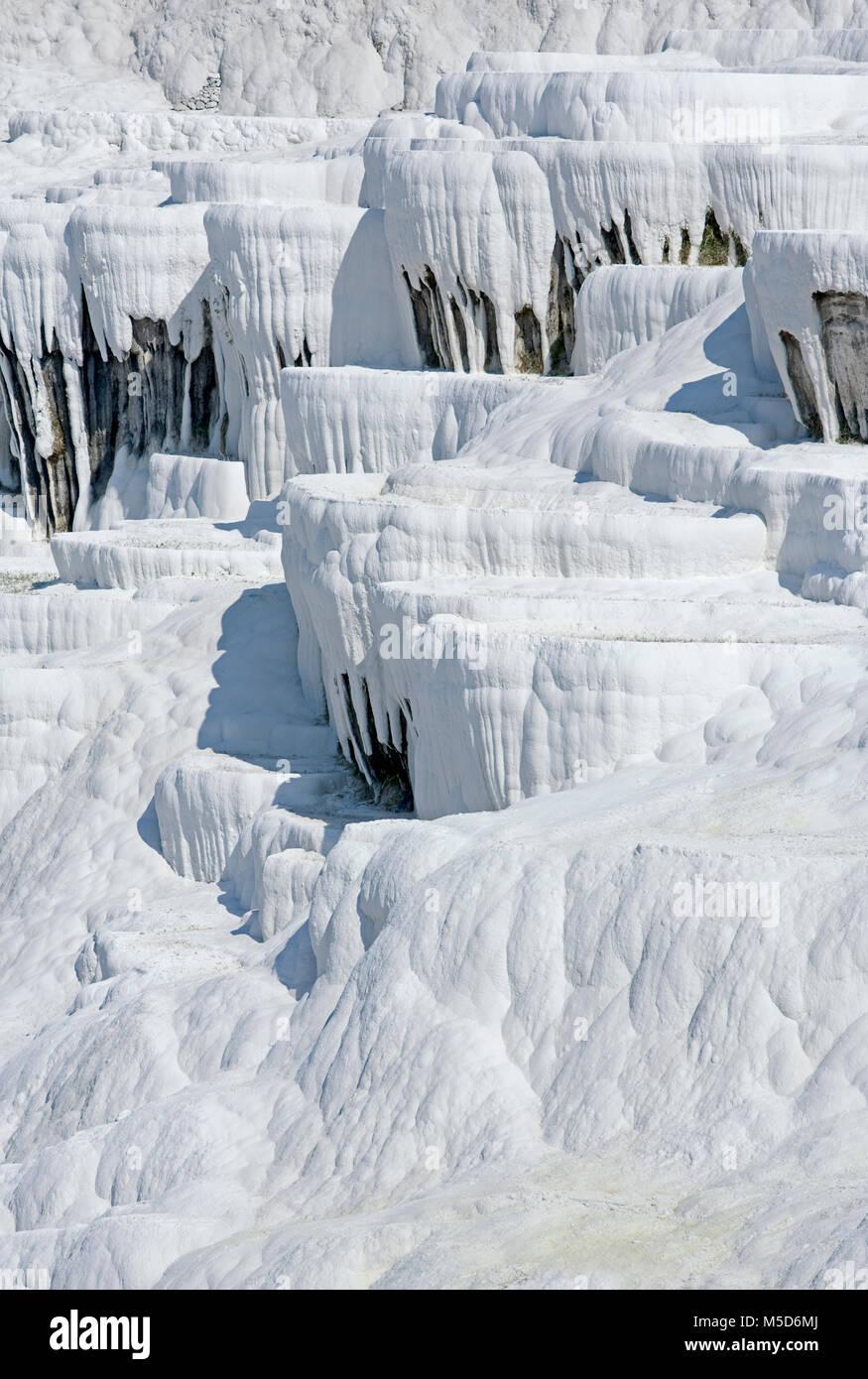 White travertine limestone rock formations known as the cotton castle, Pamukkale, Denizli, Anatolia, Turkey, Asia - Stock Image