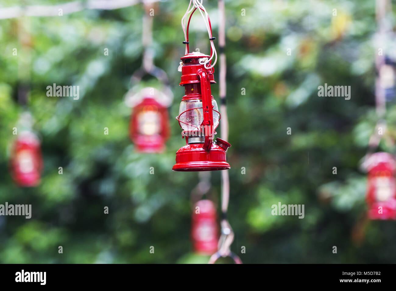 vintage kerosene oil lantern lamp hanging on the wire - Stock Image