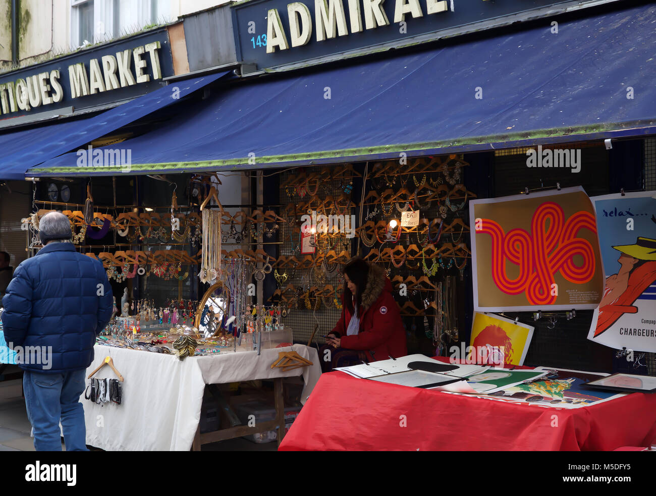 London,UK,22nd February 2018,People view the antiques at the famous Portobello Road Market in London©Keith - Stock Image