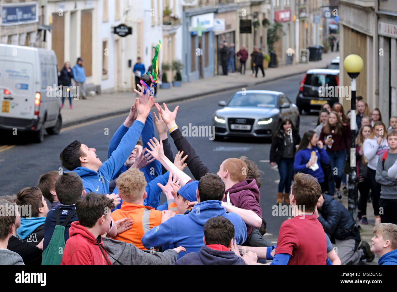 Jedburgh, Mercat Cross, UK. 22nd Feb, 2018. Jed Hand Ba' The annual game of hand ball takes place every year the Thursday after Fastern's E'en. The tradition derives from 1548 when a party of Scots recaptured Ferniehirst Castle, a mile south of Jedburgh and used an Englishman's head in a celebratory game after the battle. the Schule Ba, the first to be thrown up at 12 noon, for the boys games ( Credit: Rob Gray/Alamy Live News Stock Photo