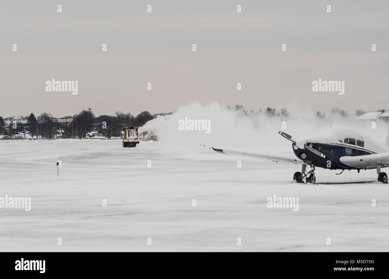 Snow Plow Small Regional Airport In Winter, Pennsylvania, USA - Stock Image