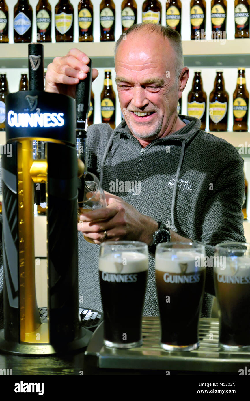 Learning to pour the 'Perfect Pint', The Guinness Academy, Guinness Storehouse, Dublin, Ireland - Stock Image