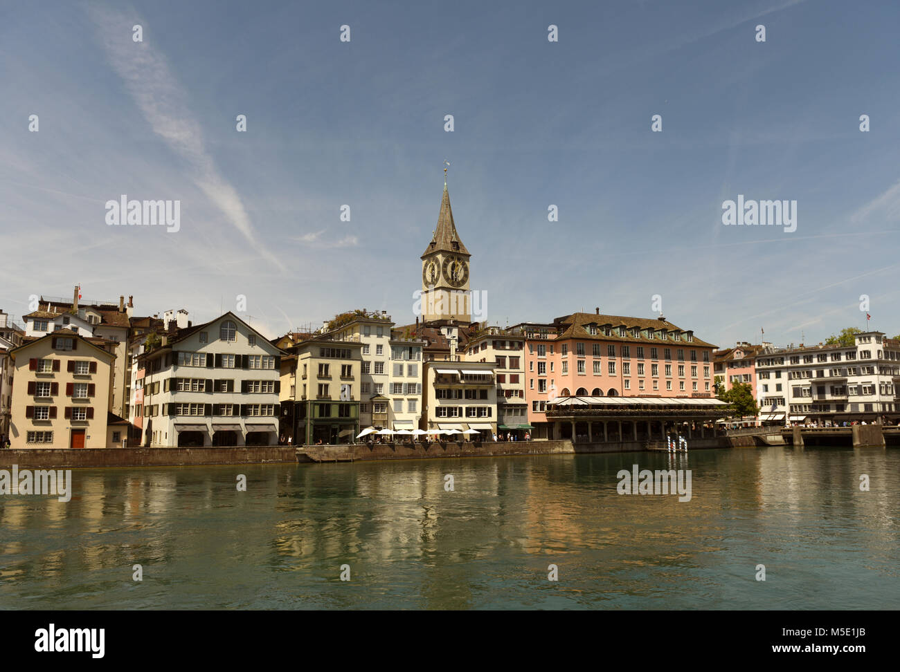 Zurich cityscape with Limmatquai and St. Peter Church, Switzerland - Stock Image