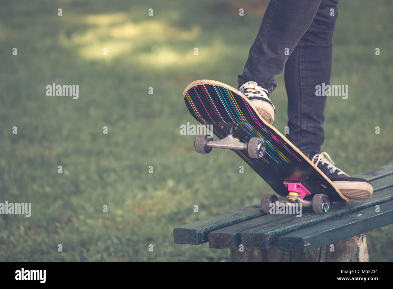 Close up of man legs ride on skate board - Stock Image