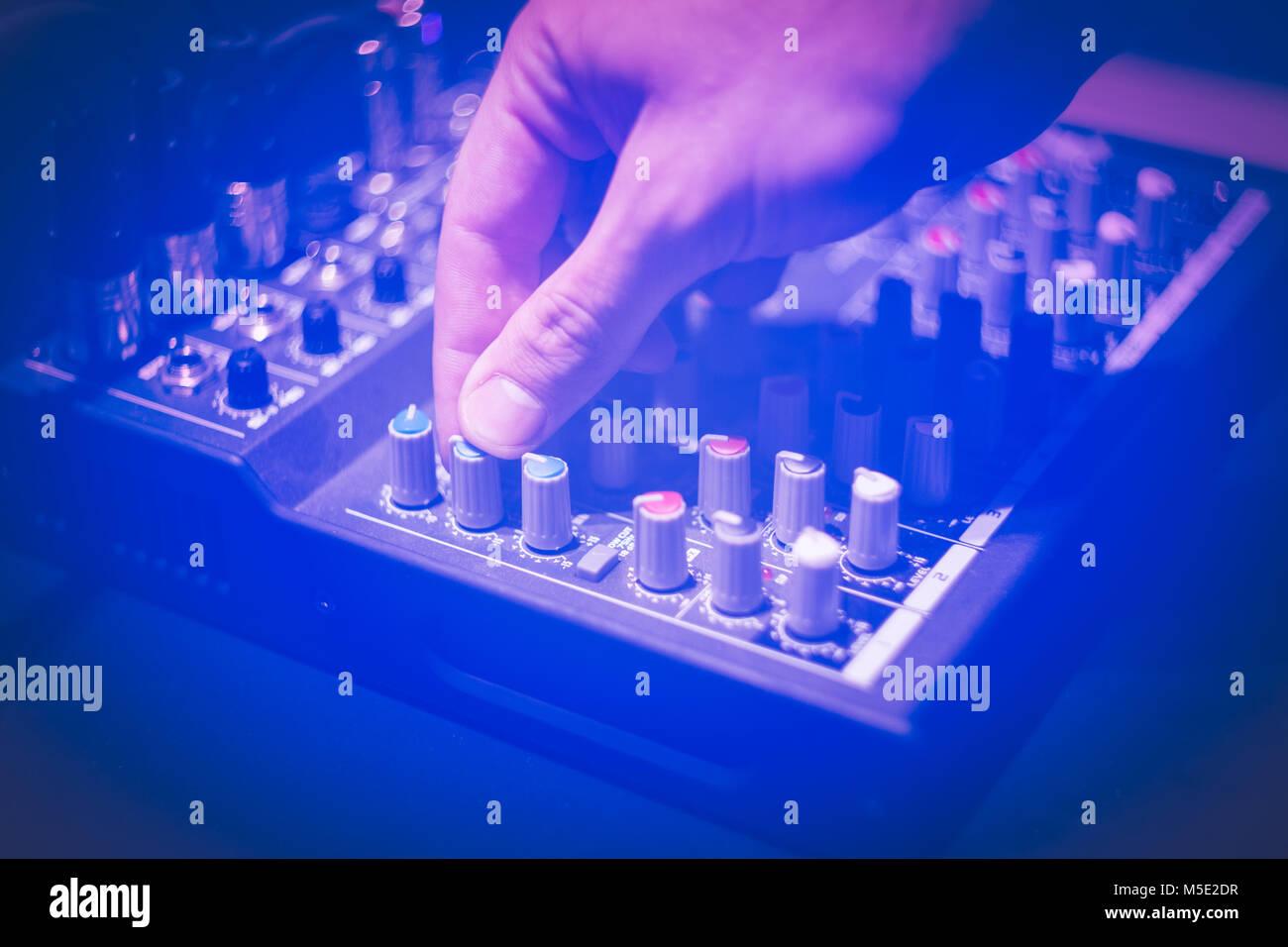 Close up of hand using studio sound equipment Stock Photo