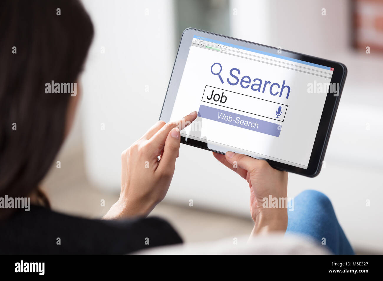 Close-up Of A Woman Searching Online Job On Digital Tablet - Stock Image