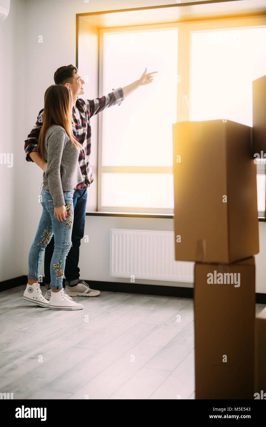 Man demonstrate and pointed to woman in window future of new house - Stock Image