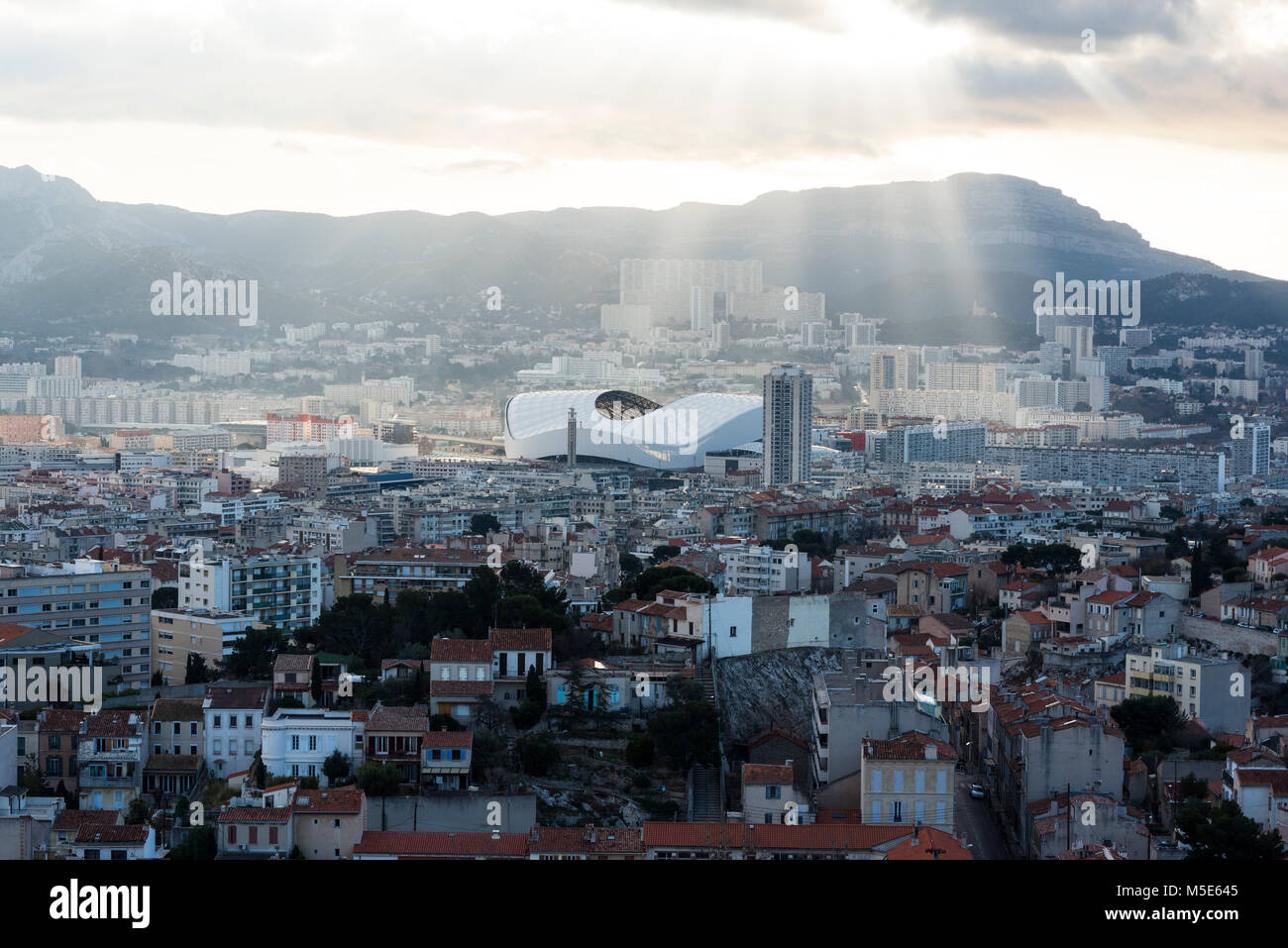 Aerial view of Marseille cityscape with the Stade Orange Velodrome in the distance. Bouches Du Rhone, France. - Stock Image