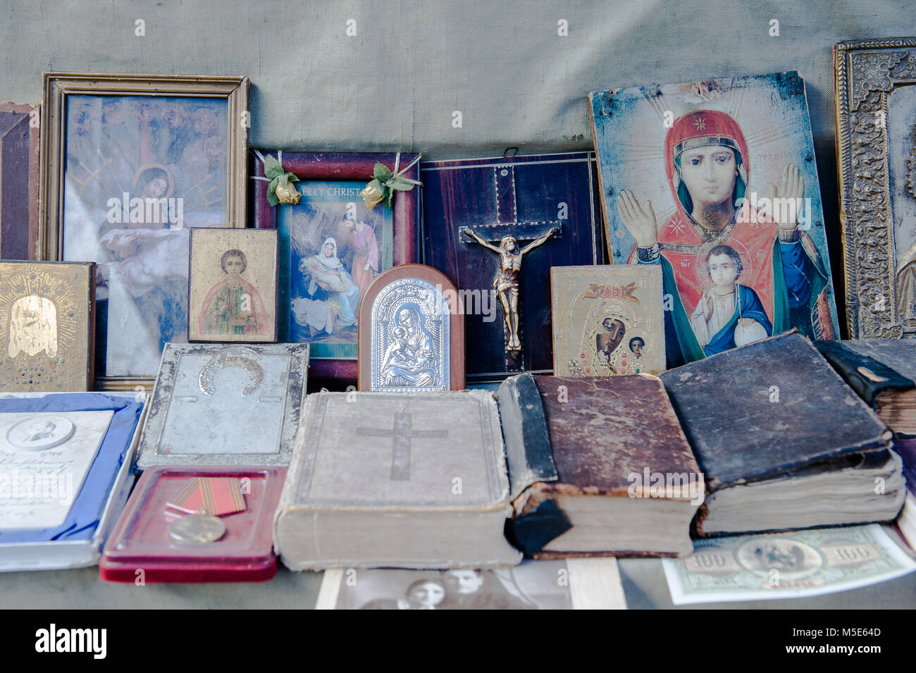 Holy relicts for sale at the Yerevan flea market, Armenia. - Stock Image