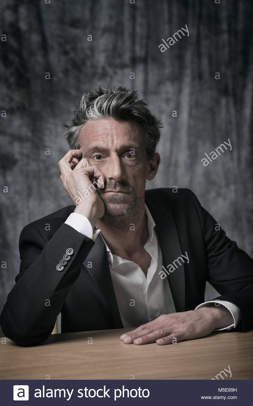 Man serious thoughtful worried thinking 50-60 - Stock Image