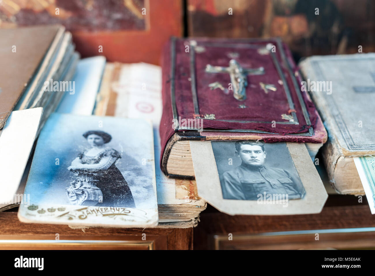 Antique bible and two pictures of a man and a woman. - Stock Image