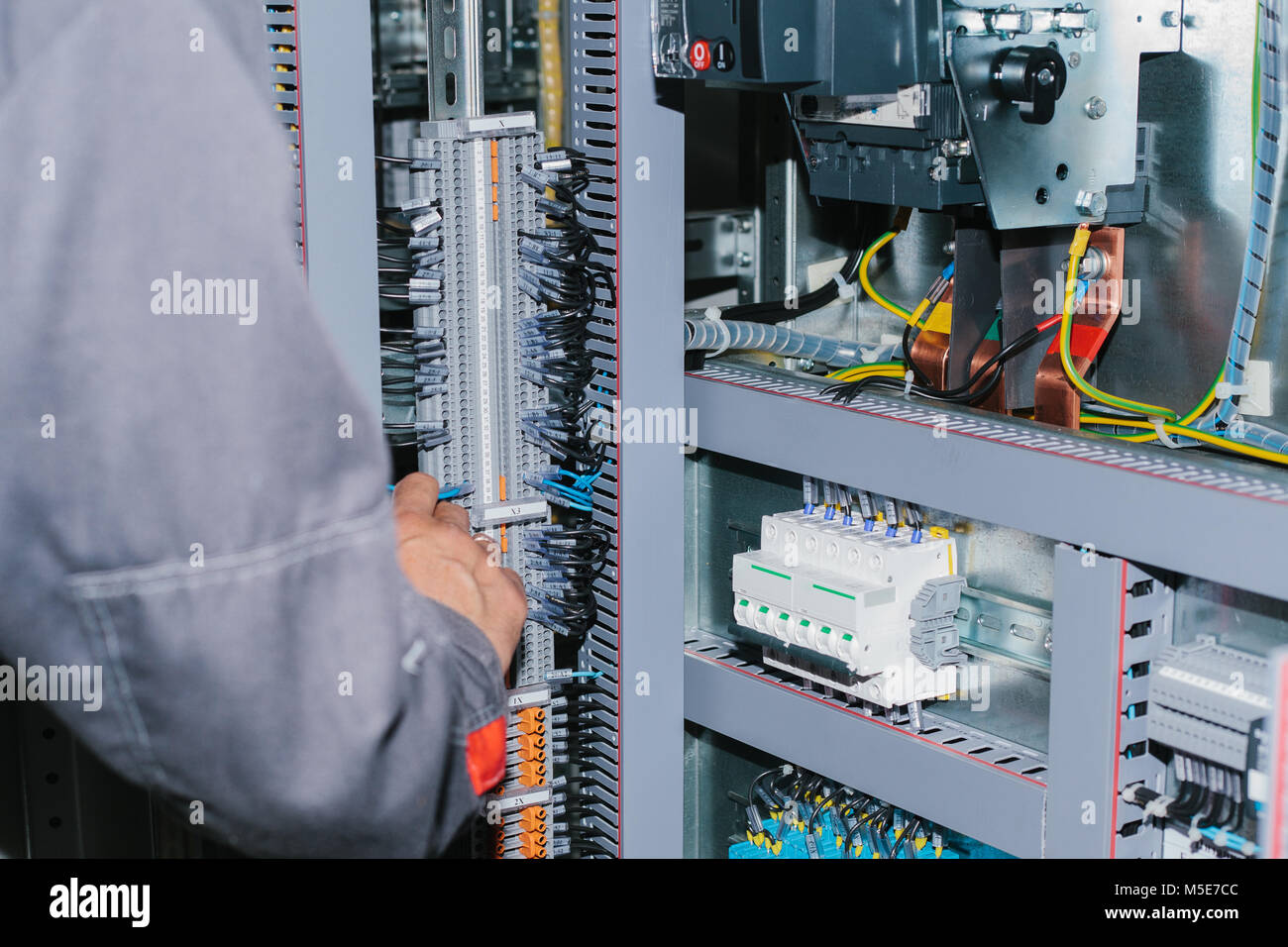 Low Voltage Stock Photos Images Alamy Home Wiring Electrician Specialist Checking Cabinet Equipment Image