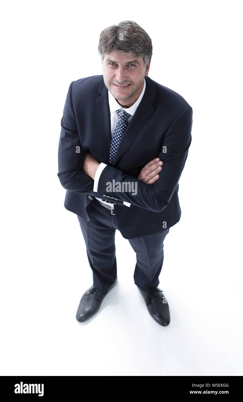 Top view of a successful businessman looking up - Stock Image